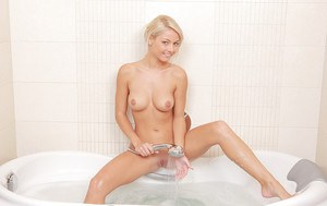Frolic blondie taking off her undies and caressing herself in the bath
