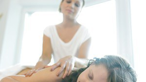 Naughty masseuse has some lesbian fun with her younger client