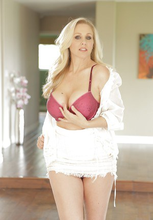 Smiley blonde mature bombshell undressing and spreading her legs
