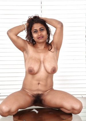 Fatty indian mature lassie with saggy tits and hairy gash posing nude