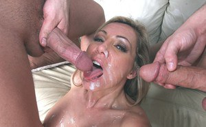 Salacious MILF gets her face glazed with jizz after double penetration fun