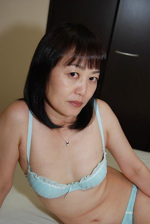 Shy asian lady in glasses strips down and has some pussy vibing fun