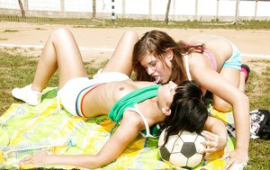 Sporty lesbian teenies have some wet pussy toying fun outdoor