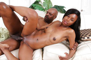 Lustful ebony gal fucks a big black boner and gets jizzed all over her face