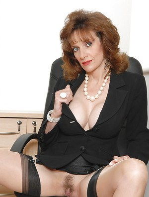 Lustful mature office lady posing bottomless at her workplace