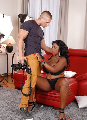 Curvy ebony lassie pleasing a white shlong with her mouth and huge jugs