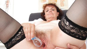 Fatty mature nurse with hairy gash has some fun with gyno tools