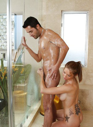 Sultry tattooed masseuse has some wet and soapy fun with her client's dick