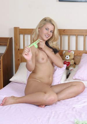 Smiley blonde cutie undressing and spreading her lower lips in close up