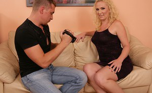 Curly-haired blonde mom gets shafted hard for jizz on her tongue and rack