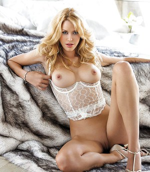 Steamy blonde temptress in sexy lingerie revealing her boobs and pussy