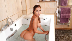 Amazingly sexy hottie with round boobies taking bath and toying her holes