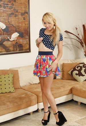 Slippy blonde sweetie with pretty smile undressing and spreading her legs