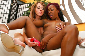 Lewd ebony lesbian has some pussy licking and toying fun with her white friend