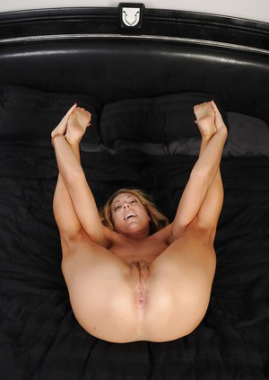 Mature lassie in lingerie and nylons revealing her soles and hairy twat