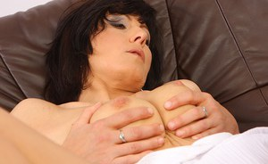 Slutty MILF gets her shaved pussy fucked and takes cum between her bosoms