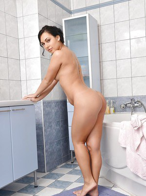 Amazingly lovely brunette demonstrating her tempting curves in the bath
