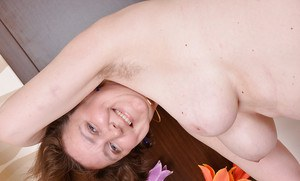 Fatty mature lassie with hairy armpits and shaggy cooter stripping down
