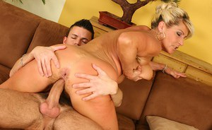 Curvy blonde mom with shaved cunt fucks a big boner and tastes some jizz