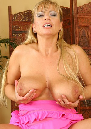 Top-heavy blonde MILF gives a titjob and gets her twat drilled tough