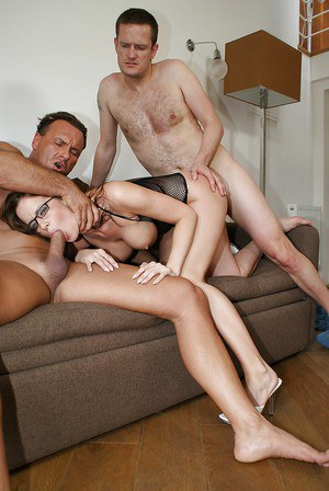 Lusty MILF in glasses gets her face glazed with jizz after DP threesome