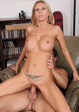 Top-heavy blonde MILF gets her shaved pussy licked and slammed tough