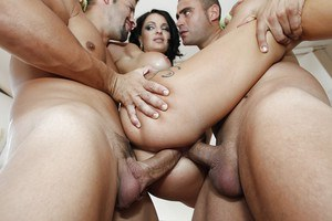 Big busted tattooed slut has some DP fun with well-hung lads