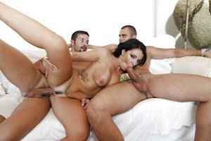 Juggy brunette enjoys a fervent threesome with double penetration