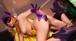 Steamy blonde in Batgirl cosplay outfit uncovering her tempting curves