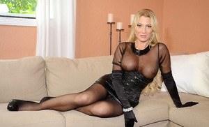 Stunning MILF in provocative outfit taking off her sheer panties