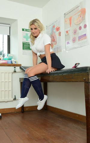Amazingly lovely blonde coed performs a reverse striptease