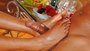 Perky ebony hottie gives a sensual blow and an oily footjob