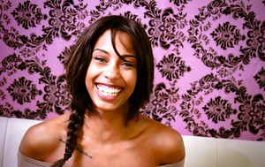 Smiley ebony floosie with pigtail uncovering her tiny titties