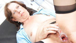 Ugly mature nurse stuffing her unshaven twat with a gyno tool