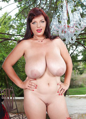 Glamorous buxom MILF with jaw-dropping big jugs getting nude outdoor