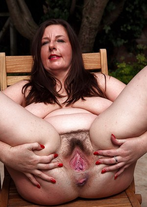 Lusty mature plumper with big saggy tits exposing her shaggy twat outdoor