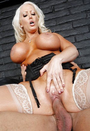 Platinum blonde cougar in stockings fucks a big cock and gets her jugs jizzed