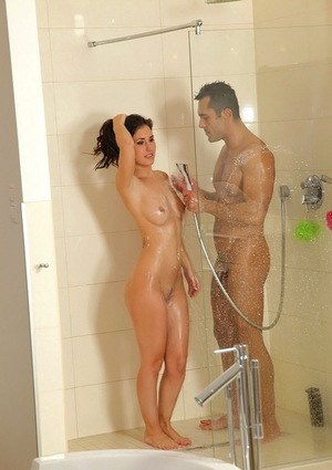 Seductive amateur gets rubbed in the shower after passionate sex