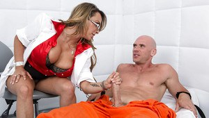 Lewd prison doctor with huge tatas gives a special treatment to hung hog