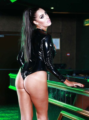 Raven-haired knockout in latex outfit revealing her boobs and pussy