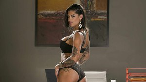 Steamy secretary in glasses revealing her tattooed curves in the office