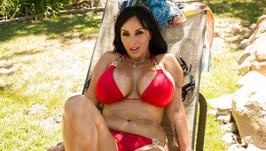 Frisky MILF taking off her bikini and oiling up her buxom curves outdoor