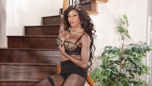 Playful ebony bombshell slowly uncovering her stunning curves