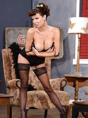 Glamorous busty MILF in stockings getting rid of her sexy lingerie