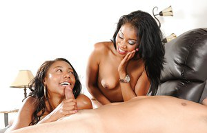 Sassy ebony chick teaching her teen friend how to suck a white cock
