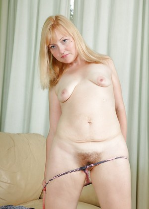 Dirty-minded mature gal uncovering her flabby curves and hairy gash