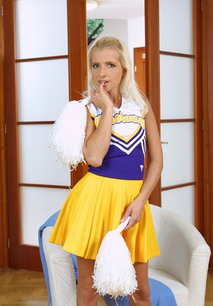 Frisky blonde cheerleader getting naked and exposing her slim curves