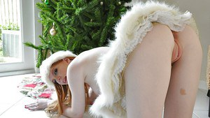 Barely clothed amateur showcasing her slippy curves by the Christmas tree
