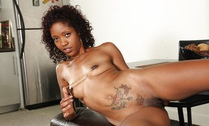Curly-haired ebony lassie gets rid of her sparkly dress and sexy panties