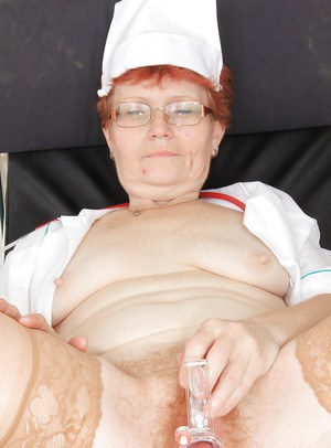 Mature gyno nurse in glasses and nylons masturbating her hungry twat